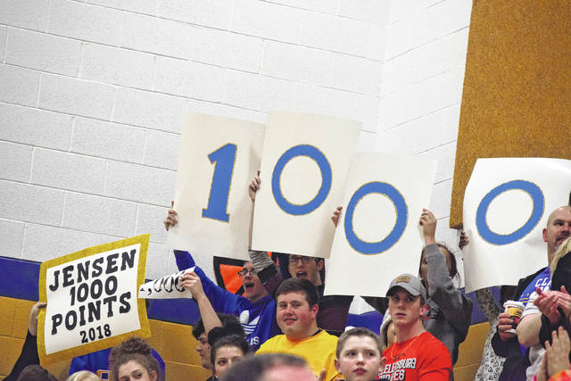 The Clay student section holds up signs decorating Warnock's 1,000-point plateau. Warnock now has 1,003 points for her career.