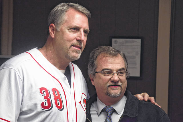 Cincinnati Reds manager Bryan Price and Portsmouth Daily Times representative Mark Richard pose for a picture.