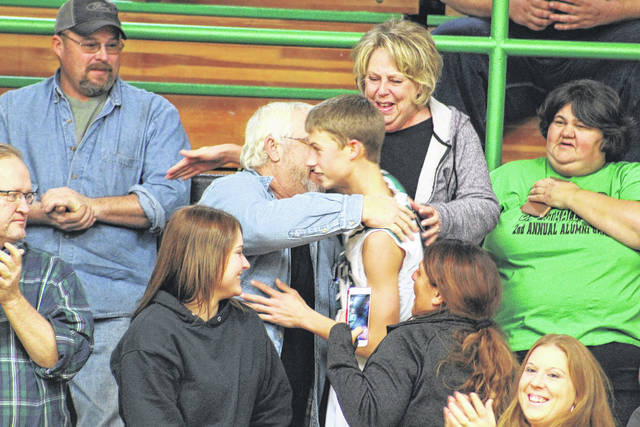 Tanner Kimbler greets his family after going over the 1,000-point plateau.
