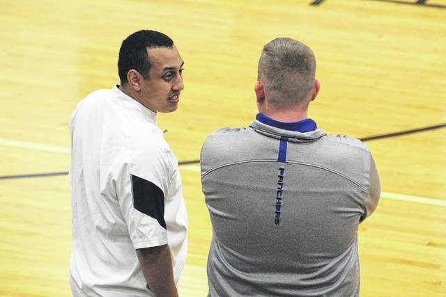 Notre Dame's Garrick Anderson and Clay's Adam Betten chat before Friday evening's game between the two programs.
