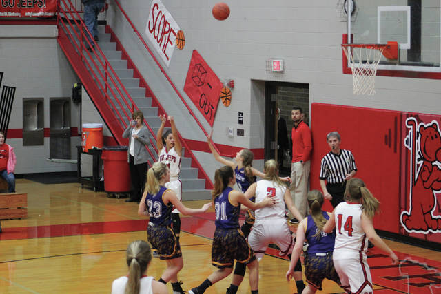 South Webster's Kaylee Hadinger shoots a corner three for the Jeeps.