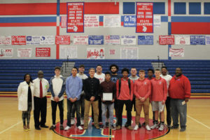 Trojans lead on court, in community