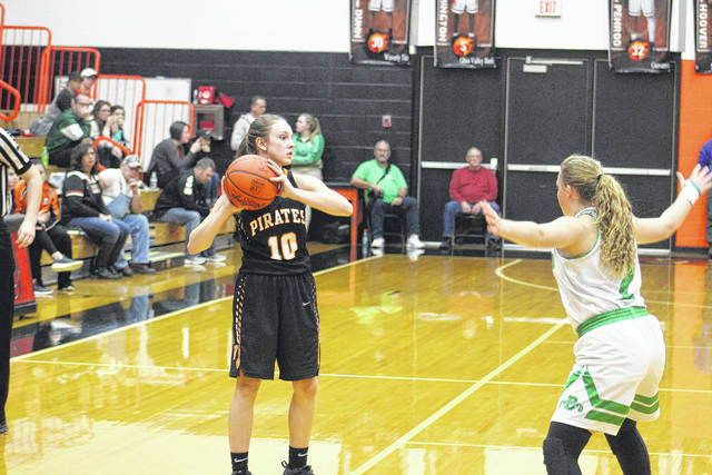 Kaylee Darnell looks for an open teammate on Saturday evening against Fairland.