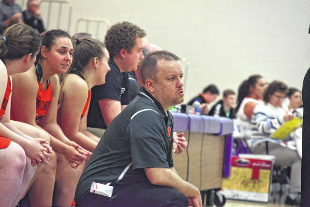West head coach Jason Claytor watches game action on Monday evening.