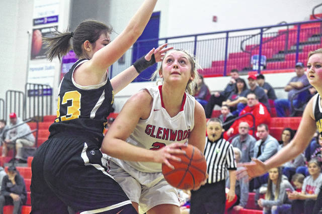 New Boston's Ali Hamilton tries to manuever past Paint Valley's Lexi Woods on Saturday afternoon.