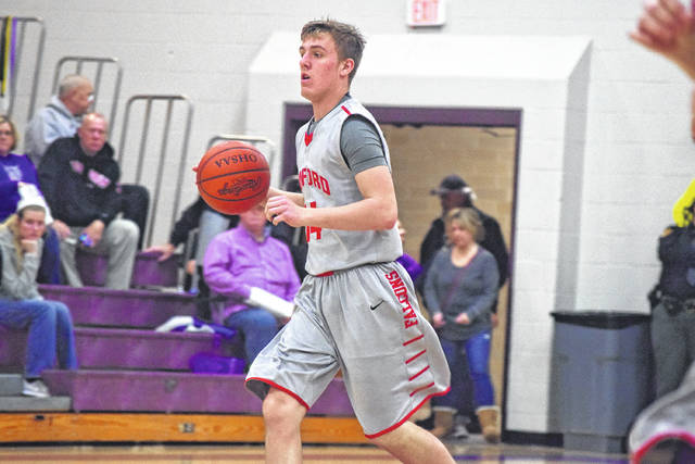Minford's Nathan McCormick brings the bal up the floor for the Falcons.