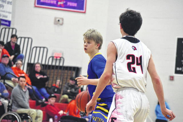 Clay's Garrett Beegan moves around the right side of the perimeter.