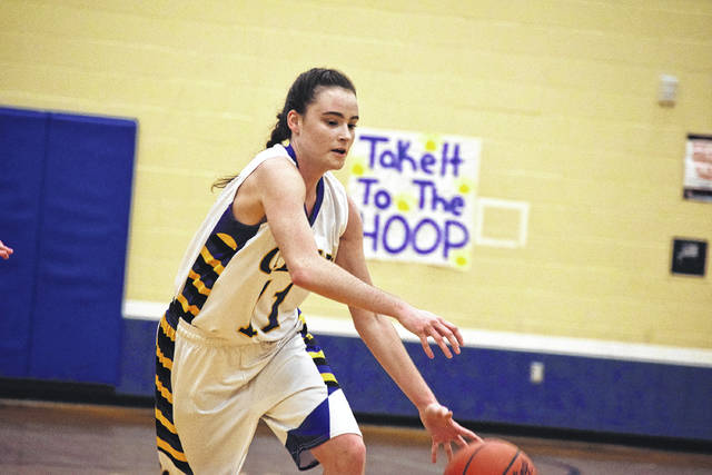 Clay's Regan Osborn takes the ball to the hoop against South Webster.
