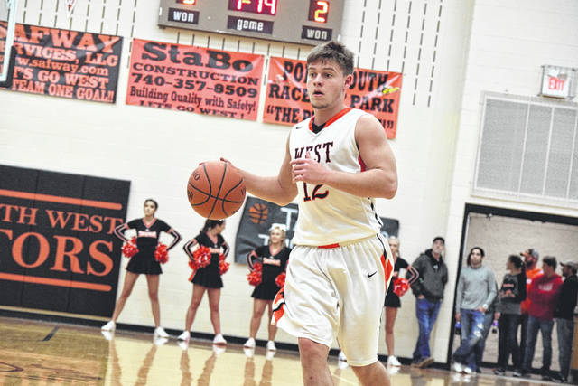 West's Josh Berry moves up the floor with the basketball.