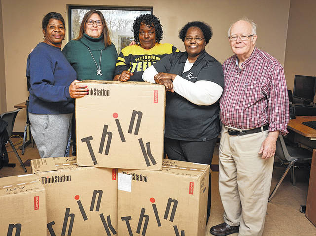 Four computers donated by Fluor-BWXT Portsmouth will be installed in the computer lab at the 14th Street Community Center in Portsmouth. From left, Yvette Jordan (14th Center), Deneen Revel (FBP), Roxanna Ferguson, Maxine Malone and Evan Fisher.