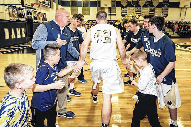 """Notre Dame senior Tyler Speas heads out onto the Titans' home floor during a prior contest. Speas, the lone senior on Garrick Anderson's squad, provided a """"coach on the floor"""" mentality for Notre Dame throughout the 2017-18 campaign."""