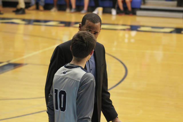 Shawnee State's DeLano Thomas talks to Gavin Brown during a stoppage in play on Thursday evening against Campbellsville.