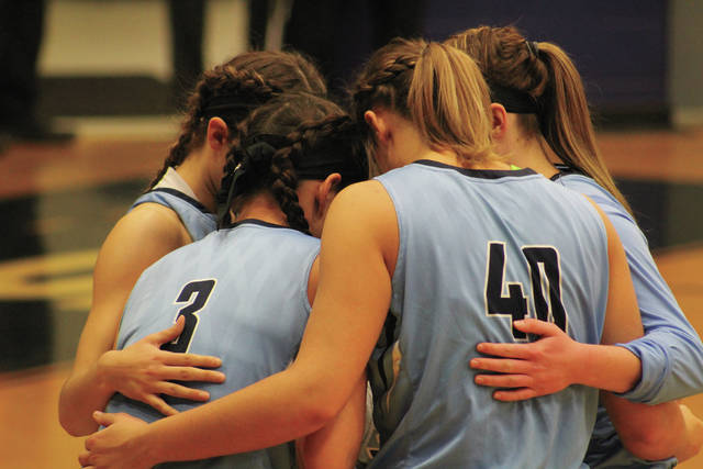Shawnee State's starting five huddle together before the start of Thursday evening's contest against Campbellsville. The Bears took home a thrilling 90-78 victory in overtime and outscored Campbellsville 15-3 in the final quarter en route to doing so.