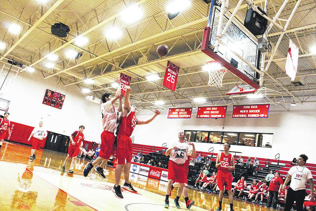 Vern Riffe School Cardinals player Johnny Royalty (in the white jersey) puts up a shot in Thursday's game against the Buckeye Hills Bucks at University of Rio Grande. The Cardinals lost 34-23.