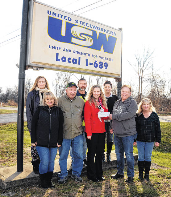 Present for the USW 1-689 Women of Steel's donation to Christmas Gifts for Children are WOS representatives along with volunteers with the Christmas Gifts program working from the DOE Portsmouth Site in Piketon. Shown, from left, Andria Smalley, Theresa Workman, Lou Thompson, Chris Jordan, Ashley Jordan, Jodi Jenkins, Mark Veach and Francie Mullins. Not pictured, Lisa Jenkins, Brook Pyle, Melissa Sammons, Sandy Stanley and Jeri Trent.