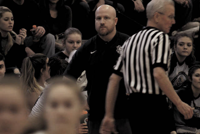 J.D. McKenzie watches his team during a home bout.