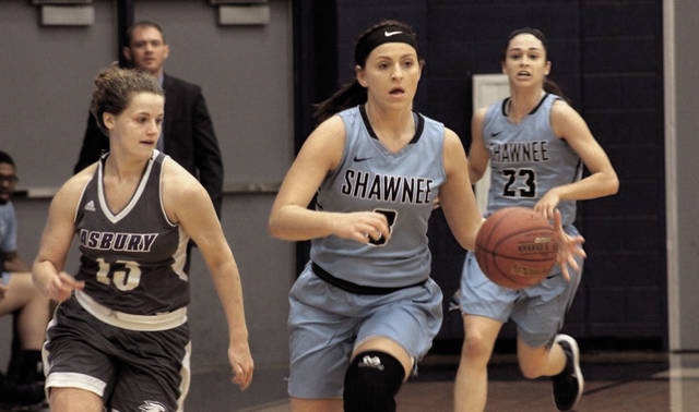 Shawnee State's Ashton Lovely moves up the floor with the basketball against Asbury.