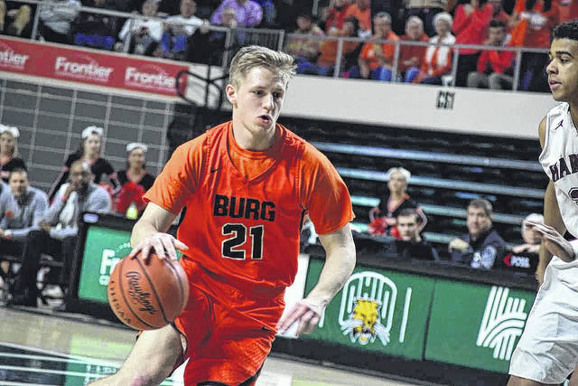 Wheelersburg's Cole Lowery drives to the basket against Harvest Prep.