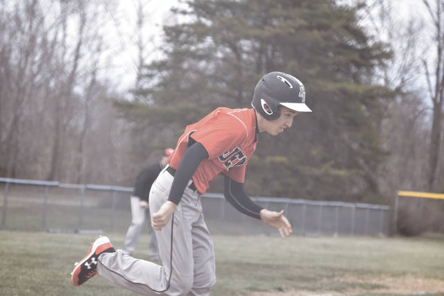 South Webster's Braden Martin sprints down the first base line.