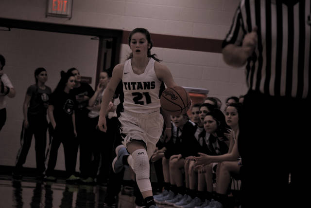 Notre Dame's Ava Hassel brings the basketball up the left side of the floor.
