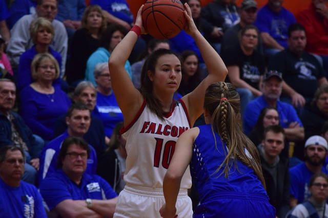 Minford's Erin Daniels holds the ball on the right wing.