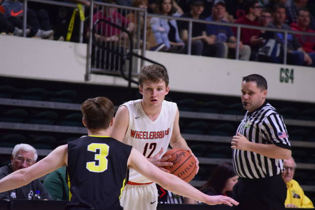 Wheelersburg's Connor Mullins sizes up Lynchburg-Clay's Noble Walker on Saturday evening.
