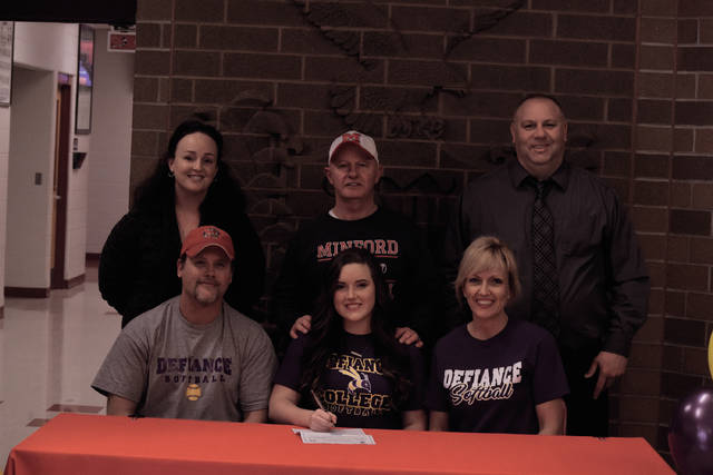 Minford's Zoe Doll, a utility softball player who has played at a distinguished level on the softball diamond and has also contributed in a strong manner on the girls basketball and volleyball units under the Lady Falcons' umbrella, signed to continue her athletic career with the Defiance College softball program last Thursday.