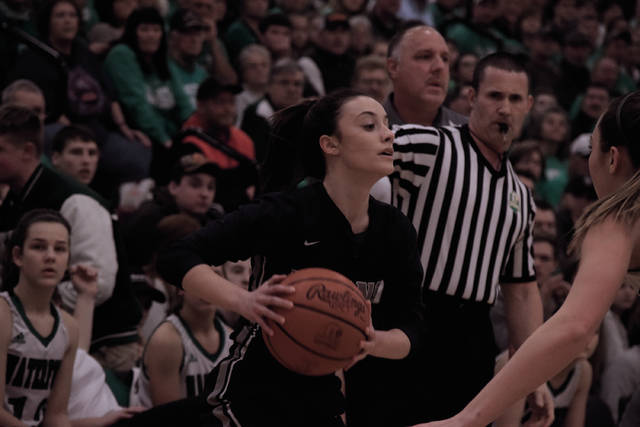 Notre Dame's Ali Smith holds the basketball out on the right wing.