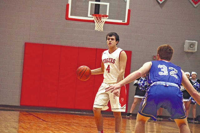 New Boston's Kade Conley sets up the offense against East during a prior contest.