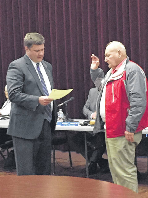 Jerrold Albrecht (right) is sworn in as 4th Ward councilman by City Solicitor John Haas.