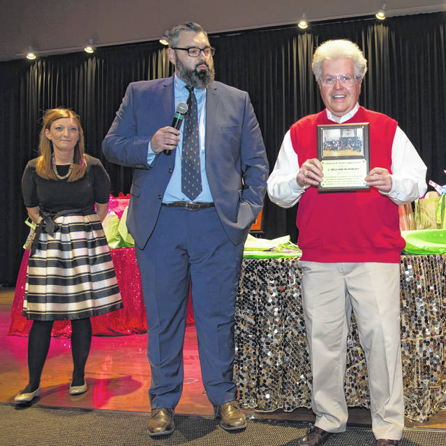 William McKinley (right) received the Clarence M. Parker Legacy Award, and was joined by Beth Mundhenk and Andy Albrecht.