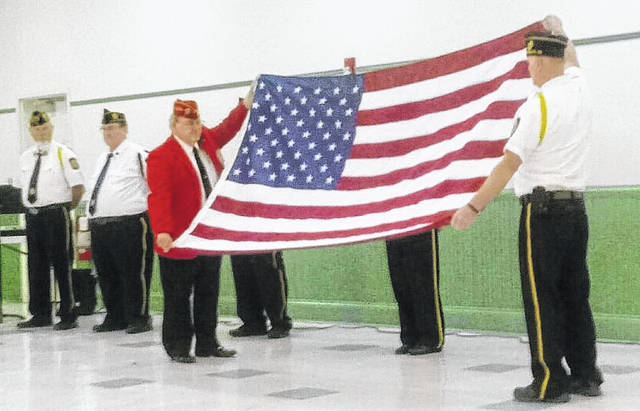 The Legion Honor Guard folding the flag for the children of Notre Dame Elementary