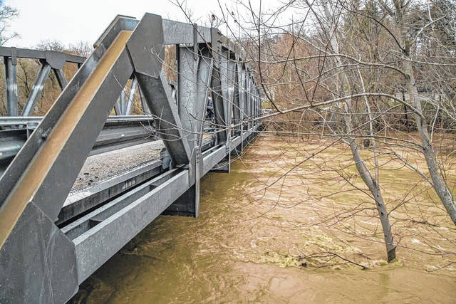 """According to the National Weather Service, """"the Ohio River is going to rise considerably"""" due to this week's rains, but is not expected to exceed flood stage as it did in February."""
