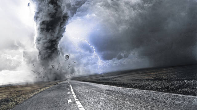 Powerful Tornado - destroying property with lightning in the background