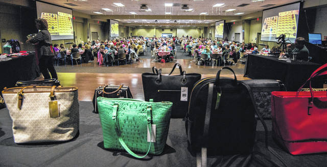 A view of the crowd of people in attendance for the PALS Purse Bingo. Some of the purses won in the forefront.