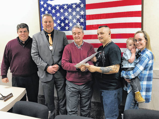 City and county officials celebrated this week the cooperation they say led to the sale of a piece of port authority property to a city homeowner. From left, Scioto County Commissioner Bryan Davis, Portsmouth Mayor Kevin E. Johnson, county development director Robert Horton, homeowner Michael Keys, his fiancee Toshia Grizzell, and her son Jaxson.