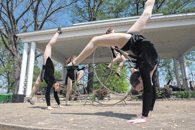 """""""We have beauty in this town year-round. There's a magic here that doesn't really happen in other communities,"""" photographer Toni Dengel told those who attended Thursday's """"Visualizing Appalachia"""" program at Shawnee State University. This is Dengel's photo of members of Cirque d'Art."""