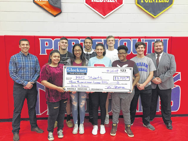 On hand for the check presentation (front, from left) Tim Glockner, Janayah Dickey, Indicah Chatman, Megan Calvin and Mikai Dixon; and (back) Isaac Kelly, Daniel Jordan, Logan Carter, Hayden Yerardi and Nate Kline.