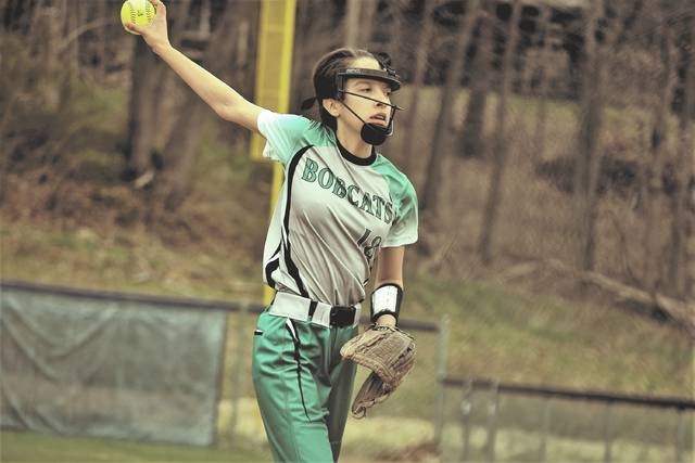 Green's Haley Bradley winds up to throw a pitch.