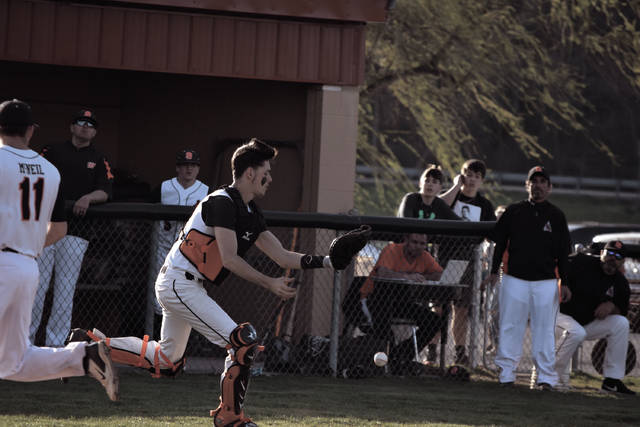West's Trevor Staggs attempts to make a catch on a flyball from behind the plate.