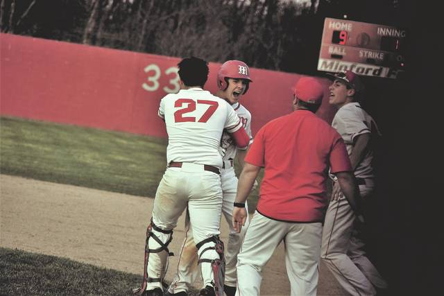 Minford's Luke Lindamood and Reid Shultz mob Elijah Vogelsong-Lewis after the latter shot a game-winning base hit into the outfield.