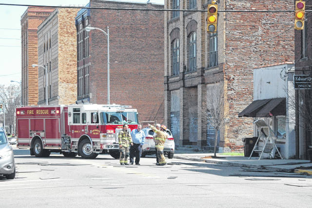 Portsmouth fire officials discuss how best to contain damage caused Thursday by high winds on Second Street.