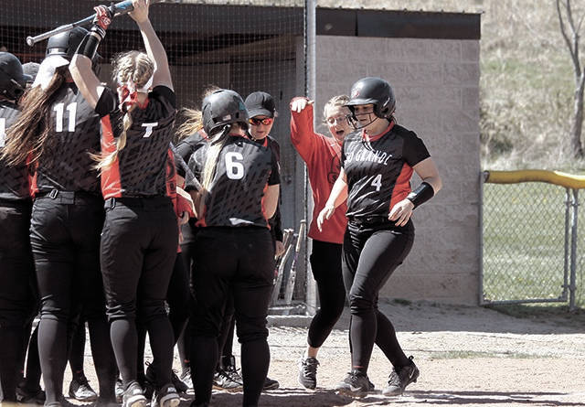 Rio Grande's Mary Pica greets her teammates at home plate after belting yet another home run.