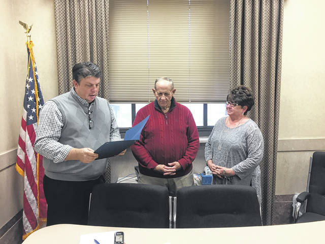 Roger Gray (center), long-time sports broadcasting personality from Portsmouth's Mix 99.3 WNXT Radio, was recognized by Scioto County Commissioners for his many years of service to the community. Commissioners Bryan Davis and Cathy Coleman presented Gray with a plaque.