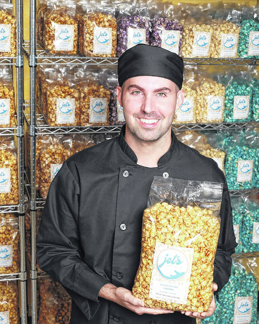 "Jethro ""Jet"" Jenkins shows off some of the wares offered at Jet's Gourmet Popcorn shop, newly opened in Portsmouth."