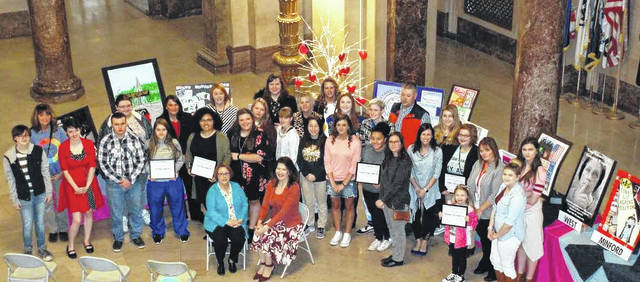 Karen Warren and Amber Davis (up front) with the students and their art teachers