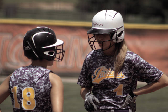 Valley's Marissa Markins (right, 4) and Kirbi Sommers (left, 18) talk to each other in between plays.
