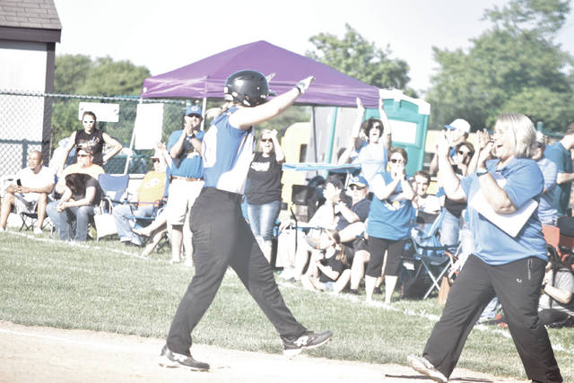 Clay's Julia Swain (left) and assistant coach Cindy Gearheart (right) celebrate after Swain brought in the tying run to send a Division IV, Region 15 matchup between the Lady Panthers and Strasburg-Franklin to extra innings. Swain had a performance to remember, pitching 12 full innings in relief and only giving up two earned runs while striking out seven in the contest.