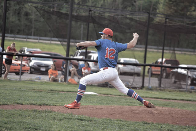 Portsmouth's Isaac Kelly throws a pitch.