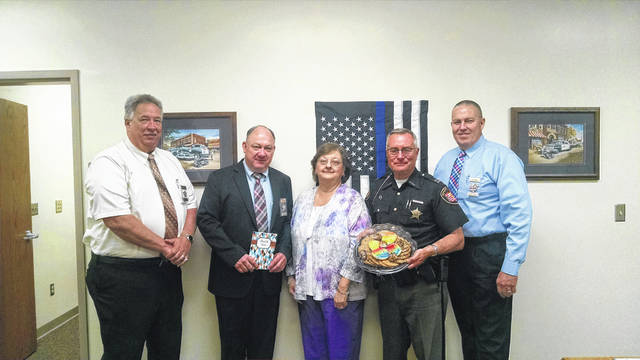 Receiving appreciation during National Law Enforcement Week were (from left) Chief Todd Miller; Sheriff Marty Donini; Cindy Stevens, director of admissions at Edgewood Manor of Lucasville; Capt. Robert Woodford and Capt. John Murphy.